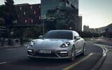An illustrative photo of a Porsche (Panamera Turbo S-E Hybrid Executive) on a city street. (Porsche)