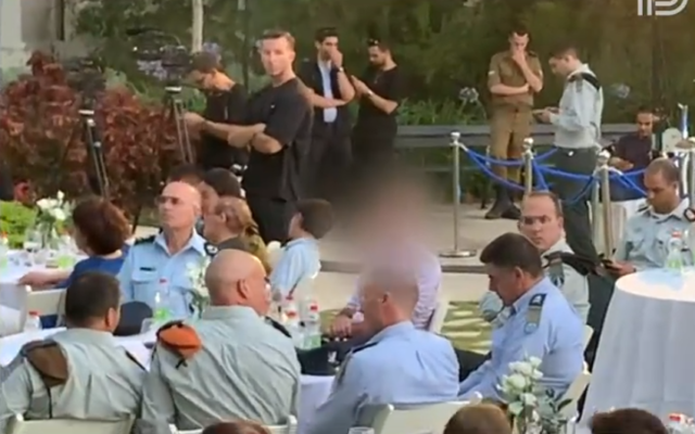 Deputy head of the Shin Bet security service, 'Resh' is seen with military officials at an undated ceremony. (Screenshot: Channel 13 news)