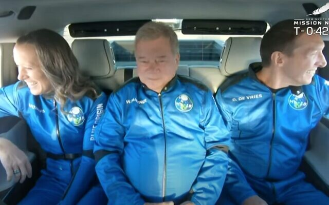 William Shatner (center) with his fellow space travellers, heads to Blue Origin's New Shepard rocket at its spaceport near Van Horn, Texas, Wednesday, Oct. 13, 2021, en route to becoming the oldest person in space. Also on the flight: Chris Boshuizen, Audrey Powers and Glen de Vries (AP Photo/LM Otero)