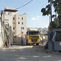 This screenshot from video released by Peace Now on October 21, 2021, shows construction on new settlement units in the West Bank city of Hebron. (Screenshot/Twitter)