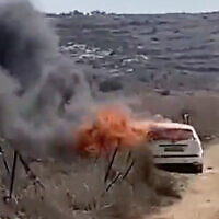 A screen capture from video shows a car burning near the West Bank village of Turmus Ayya, after it was allegedly set ablaze by settlers from a nearby outpost, October 23, 2021. (Screen capture: Twitter)