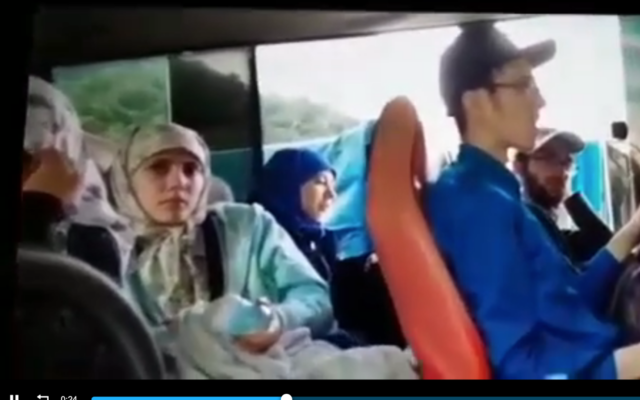 Screen capture from video purportedly showing members of the extreme ultra-Orthodox cult Lev Tahor on a bus that was stopped by Guatemalan authorities, October 17, 2021. (B'Hadrei Haredim)