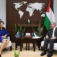 Swedish Foreign Minister Ann Linde meets with Palestinian Authority premier Mohammad Shtayyeh in Ramallah on Tuesday, October 19, 2021 (WAFA)
