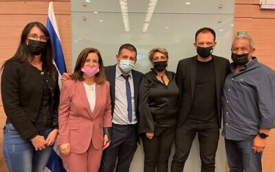 Coalition MKs Yael Ron, Ghaida Rinawie Zoabi, Alex Kushnir, Nira Shpak, Vladimir Beliak and Meir Yitzhak Halevi pose for a photo after advancing the government's budget proposal through the Knesset's Finance Committtee on October 28, 2021. (Knesset Spokesperson's Office)