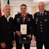Israeli Air Force chief Amikam Norkin, center, receives the Order of Merit of The Federal Republic of Germany from German Ambassador to Israel, Susanne Wasum-Rainer, and German air force chief Ingo Gerhartz on October 17, 2021. (Israel Defense Forces)