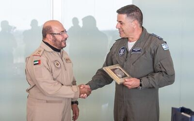 Emirati air force chief Ibrahim Nasser Muhammed al-Alawi, left, shakes hands with Israeli Air Force chief Amikam Norkin after he lands in Israel to observe to observe the IAF's Blue Flag exercise on October 25, 2021. (Israel Defense Forces)