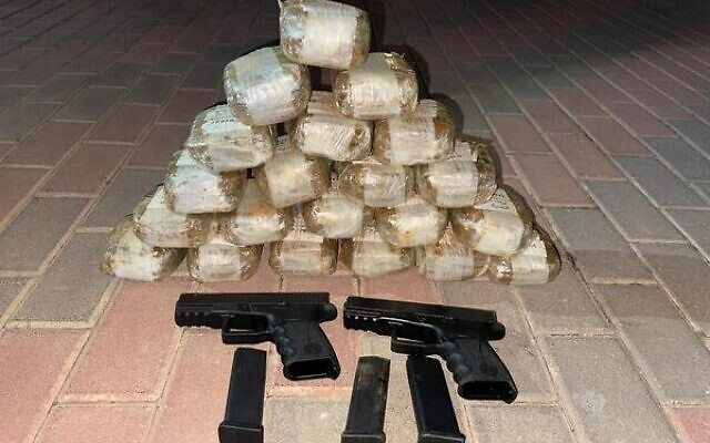 Drugs and guns that Israel Police and the Israel Defense Forces say were smuggled from Lebanon, October 23, 2021 (Israel Police)