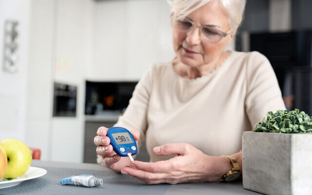 A diabetic woman checking blood sugar level at home. (iStock via Getty Images)