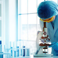 An illustrative photo of a scientist in working in a lab. (Rapeepat Pornsipak via iStock by Getty Images)