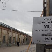 A man stands inside the Riga Ghetto Museum in Riga, Latvia, January 11, 2014. (Fishman/Ullstein via Getty Images via JTA)