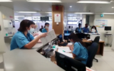 Hospital staff at Hillel Yaffe Medical Center log patient details with pen and paper, following a ransomware cyberattack, October 13, 2021. (Hillel Yaffe Medical Center)